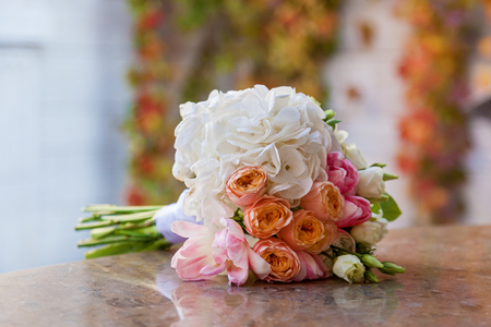 wedding bouquet for a bride on a marble table Stock Photo