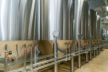 equipment for beer production, private brewery, Contemporary large steel barrels in winery, food industry