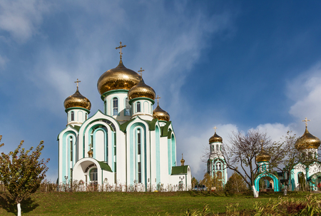 Orthodox church with golden domes in autumn sunny day, Church of All Saints in Carpaty Stock Photo