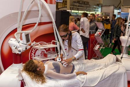 Ukraine Kiev 22 September 2017: Woman in a white suit receiving anti-cellulite massage LPG Massage procedure on a female body. Body care.