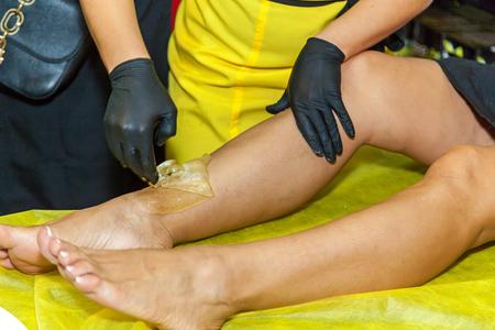Ukraine Kiev 22 September 2017: Cosmetic procedures Sugaring demonstration of hair removal Editorial