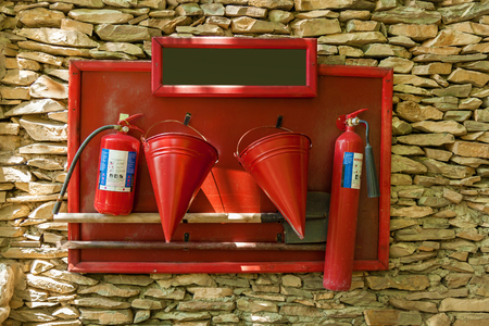 A protective shield with a tool for firemen: buckets, shovel, fire extinguishers, scrap.Protective shield with a tool for firemen.journey to Georgia Stock Photo