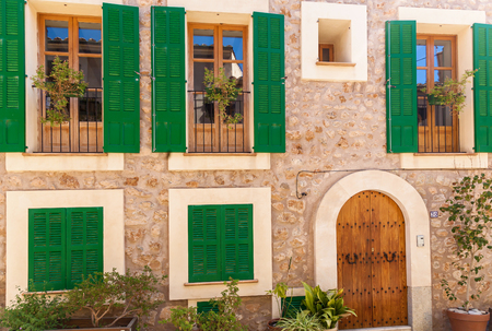 Green shutters on the house, to protect against external damage. Green shutters.Palma de Mallorca house.