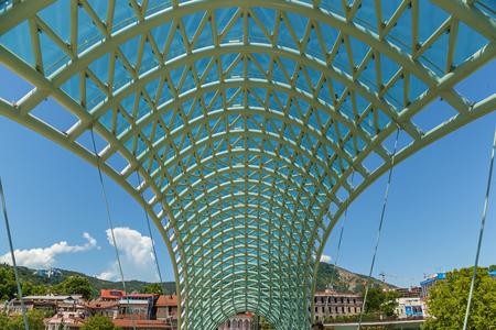 The Bridge of Peace is a pedestrian bridge over the Kura River in Tbilisi, Georgia. Bridge of Peace in Tbilisi, Georgia. Stock Photo