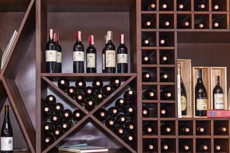 Ukraine Kiev January 25, 2018: The bottles of the vein are laid out on the shelves. Bottles of wine on the shelves.