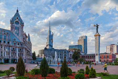 Batumi Georgia 11 July 2017: Radisson Blu Hotel and Medea statue holding the Golden Fleece. The statue is sculpted by Georgian architect Davit Khmaladze.