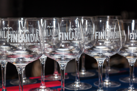 Ukraine Kiev March 22, 2016: Bar counter and glasses with the inscriptions Finlandia. Finlandia is the Finnish vodka, owned by the Brown-Forman corporation. Editorial