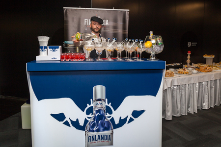 Ukraine Kiev March 22, 2016: The barman makes a cocktail Finlandia Grapefruit Tonic.Finlandia Grapefruit is a Finnish vodka belonging to the Brown-Forman corporation.