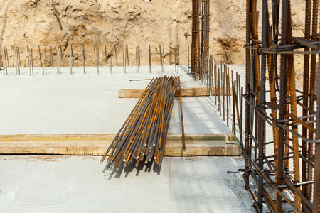 Construction workers fabricating steel reinforcement bar at the construction site.The reinforcement bar was ties together using tiny wire.