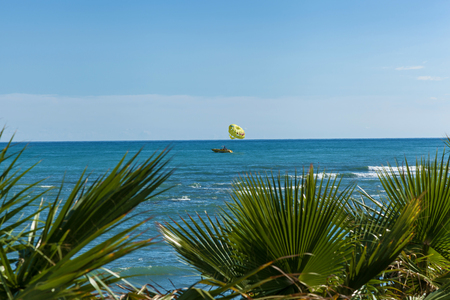 Parasailing in a blue sky in Alanya. Parasailing in Alanya, Turkey Stock Photo