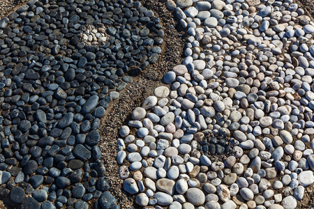 The conception of yin and yang is laid with stones on the sand,Yin and yang of stones Banco de Imagens