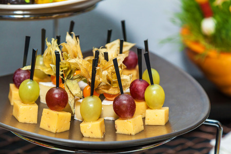 rows of tasty mini canapes with brie cheese and grapescanape with cheese and grape - Mini Canape