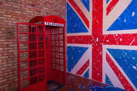 United Kingdom Flag and red telephone booth, vintage wall texture background for design and creativity.