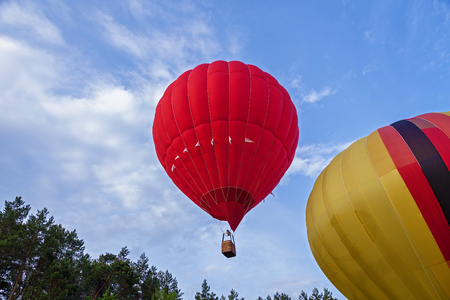 A balloon filled with hot air rises to the top to the shelves. Balloon in flight. Festival of balloons
