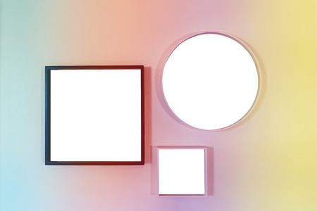 Square and round frame for photo on a white wall. blank template frame set hanging on the wall