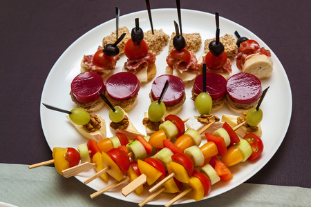 Various cold snacks on croissants for a buffet table, Catering for holidays and events
