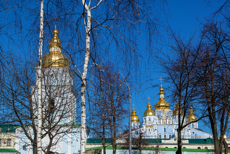 View from the park to the Mikhailovsky Monastery. St. Michael's Monastery, an architectural structure of the Orthodox church with golden domes, Kiev Ukraine