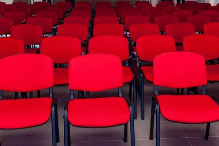 Conference room with a red stage and red chairs for events, conferences and seminars Stok Fotoğraf