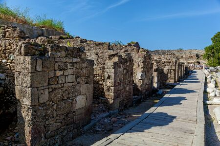 Old stone road with columns and ruins of the city of Side Turkey Imagens