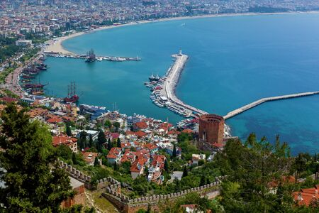 View of the resort town of Alanya, the Lighthouse in the port of Alanya, the old fortress of Alanya, Turkey. Stok Fotoğraf