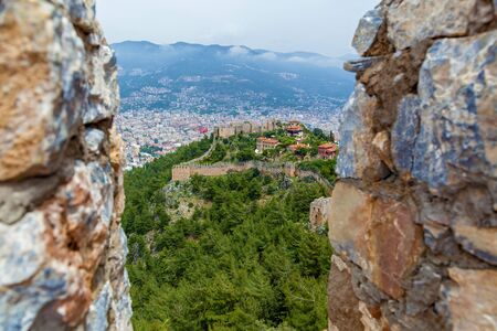 View of the resort town of Alanya, the Lighthouse in the port of Alanya, the old fortress of Alanya, Turkey. Reklamní fotografie