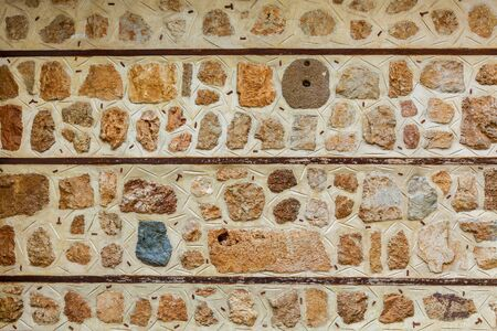 Texture of stone walls, old stones. Background of old stone wall