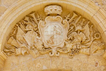 Sculptures on the facades of buildings and the architecture of the city of Mdina in Malta .Sights of the island of Malta