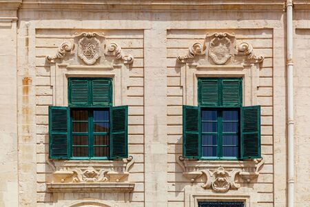 Malta architecture. Sculptures on the facades of buildings and the architecture of the island of Malta