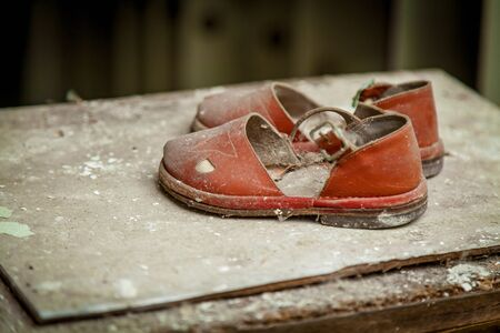 Children's shoes in the abandoned building of the kindergarten after the explosion of the Pripyat reactor, Chernobyl. Stock fotó