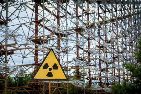 Radiation sign on the former military radar system of the Duga in the Chernobyl Exclusion Zone, Ukraine