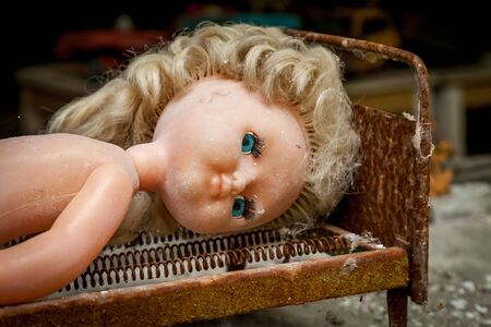 A doll in an abandoned kindergarten building after the explosion of the Pripyat reactor, Chernobyl. Stock fotó
