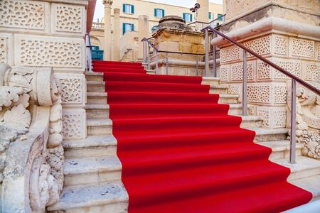 Red carpet on the stairs of the old town of Valletta, used to mark the route at the ceremony of Valletta film festival Malta, Europe