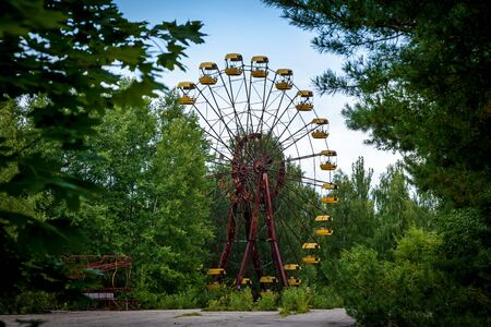 The abandoned Ferris wheel in the amusement park in Pripyat. Chernobyl nuclear power plant zone of alienation Stock fotó