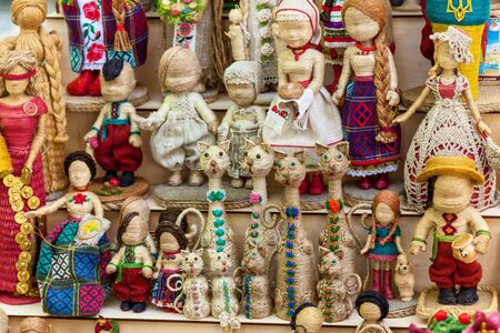 Variety of traditional Ukrainian rag dolls were dressed up in Ukrainian clothes at the market for sale.