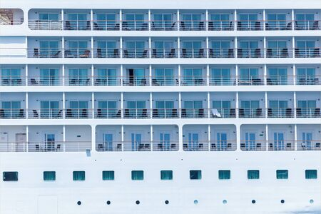 A close-up view of a big passenger cruise ship with specially constructed boats for rescuing peoples life at sea.