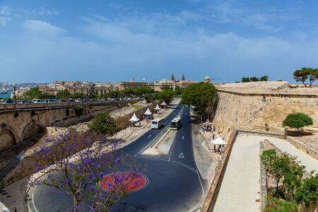 A top view of an empty bus stop on the main road on a sunny summer day on the background of blue sky in Valletta, Malta