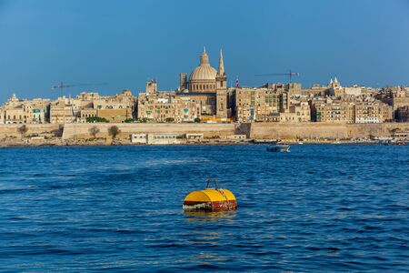 Beautiful cityscape with ancient architecture of the Valletta city in Malta. The building of the Cathedral of St. Paul on a background. Reklamní fotografie