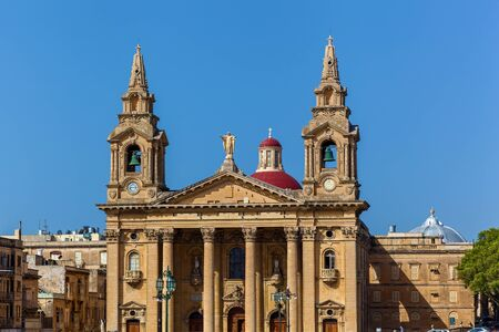 A Roman Catholic parish church is located at a big square with pink oleander in Floriana, Malta