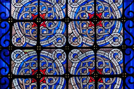 A beautiful stained glass on the window with multi-colored glass in a church, Lviv.