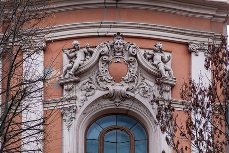 An old stone sculptures on the facade of House of Scientists in Lviv. Stock Photo