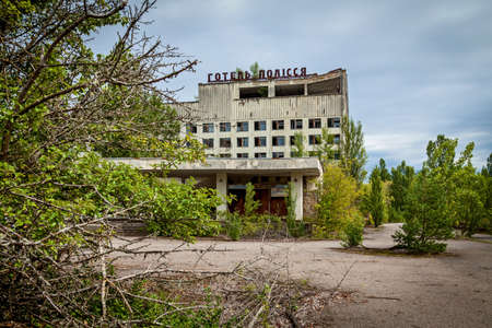 Ukraine Pripyat August 11, 2019: Abandoned building in the city of Pripyat, ghost town of the Chernobyl nuclear power plant affected by the nuclear disaster in 1986, Chernobyl Exclusion Zone, Ukraine. Sajtókép