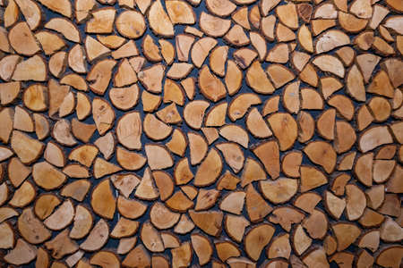 Wall decor made of wood pieces. Wood texture from logs