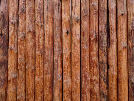 Wooden wall of a fence or house, wooden texture from logs