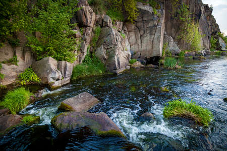 Boguslavsky granite canyon, Ukraine. Rapid flow of the Ros river near granite rocks. Sights and nature of Ukraine. 版權商用圖片