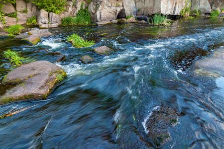 Boguslavsky granite canyon, Ukraine. Rapid flow of the Ros river near granite rocks. Sights and nature of Ukraine.