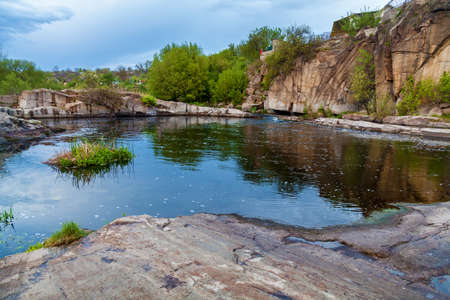 Boguslavsky granite canyon, Ukraine. Rapid flow of the Ros river near granite rocks. Sights and nature of Ukraine.