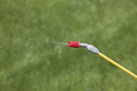 splutter: Device of spraying pesticide sprinkle liquid from red nozzle.