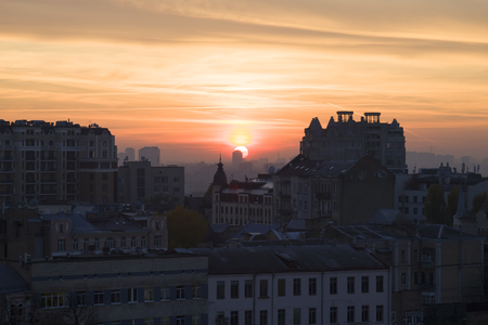 Panoramic view of the city of Kiev. Sunset straight into the lens.