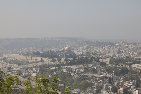 ministration: Panoramic view at noon haze from the Mount of Olives on the old city of Jerusalem, Israel.