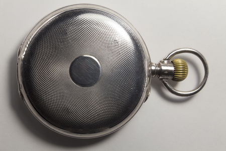 chainlet: Antique watches made of silver metal. The cover of watches is closed.